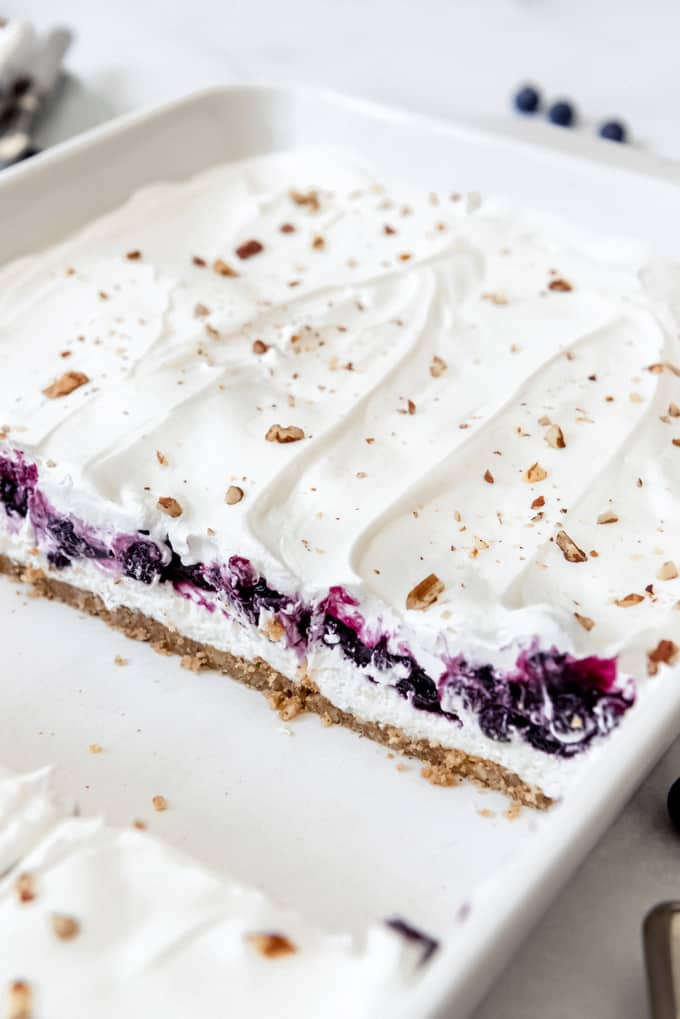 Blueberry delight - a pan of no bake blueberry lush in a white pan.