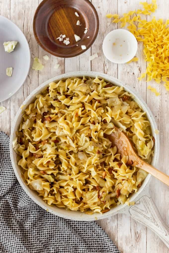 Pan full of Haluski, fried cabbage and noodles.