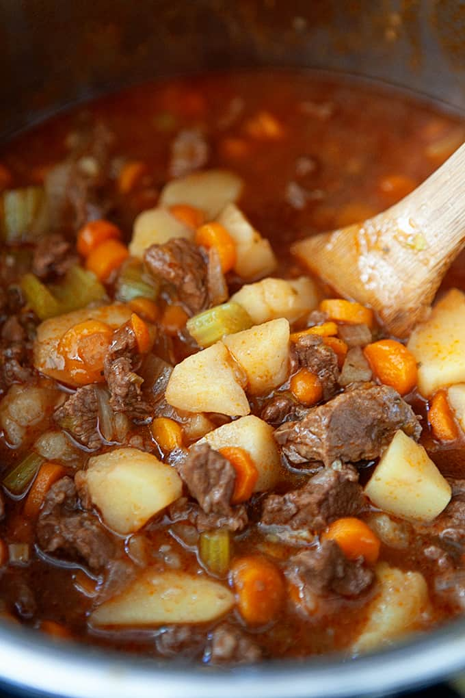 Stirring a pot on beef stew.