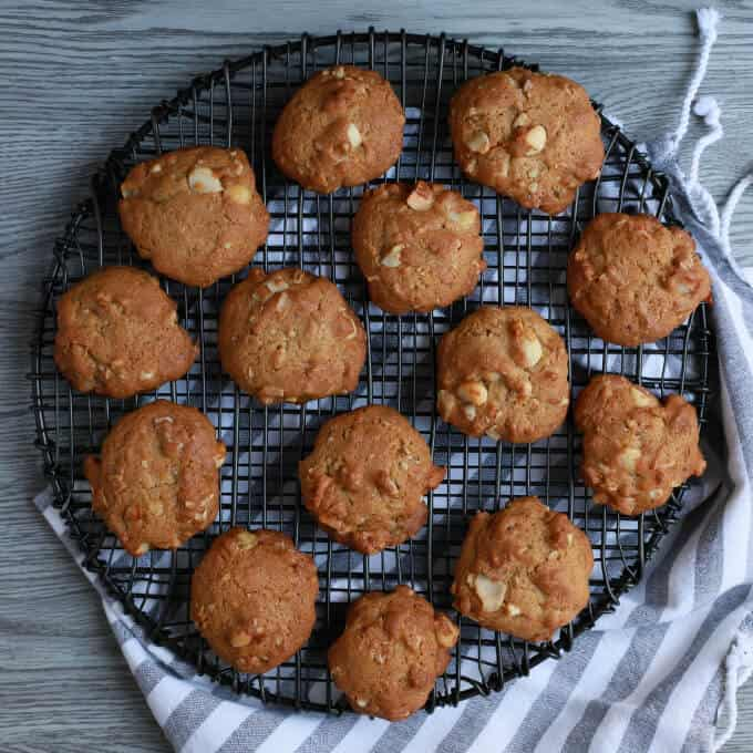 Baked cookies on a round black baking rack.