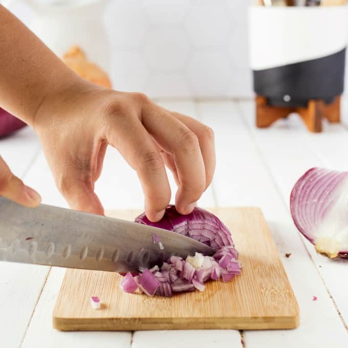 Dicing an onion with a sharp kitchen knife