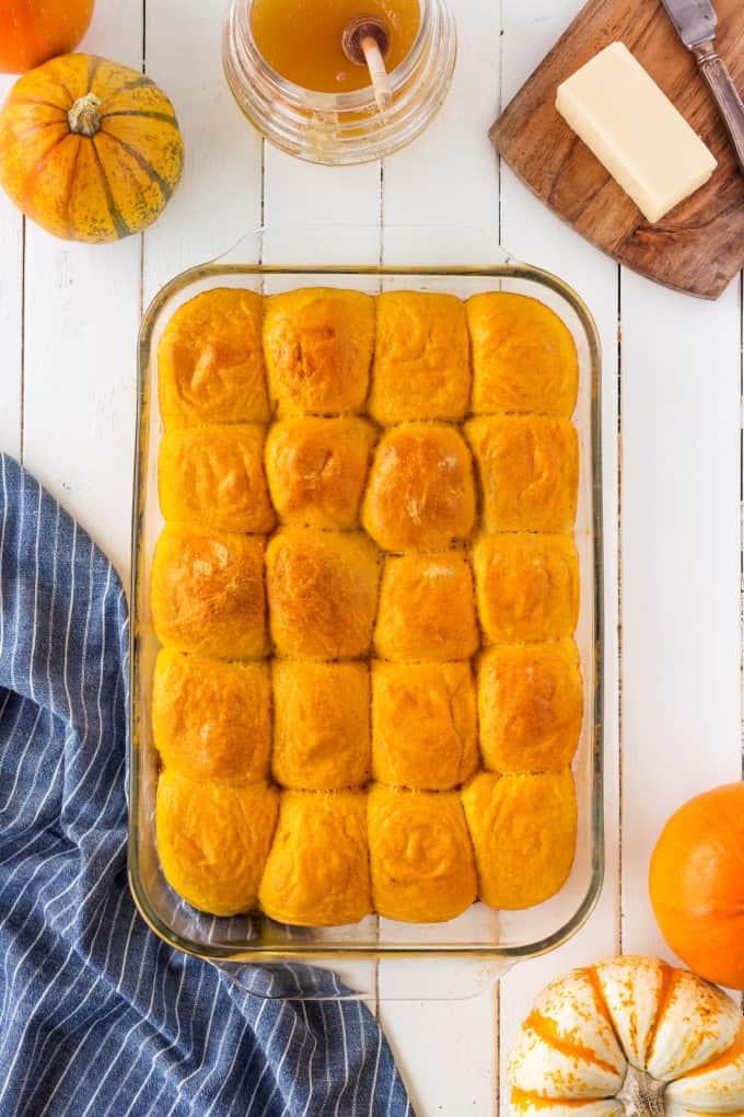 Pumpkin Dinner Rolls in a glass baking dish.