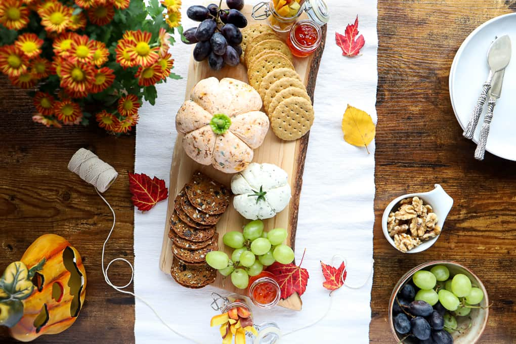Overhead shot of a cheese board with all the fixings.