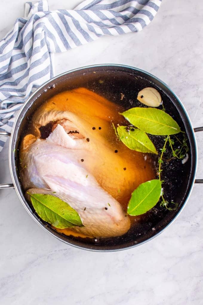 Turkey being brined in a pot.