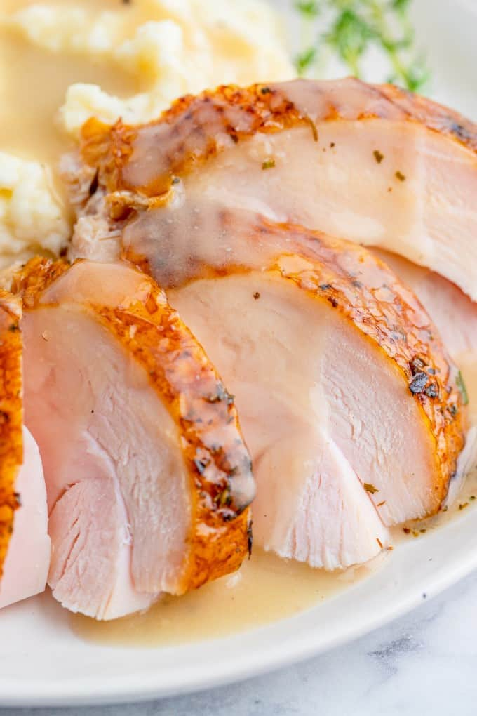 Close up of sliced turkey breast with gravy