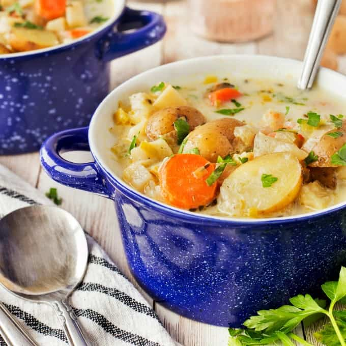 Square image of blue bowls of German Potato Soup