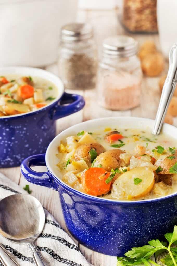 Two blue bowls of hearty German Potato Soup