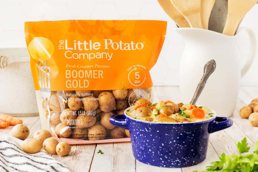 Bowl of German Potato Soup with a bag of The Little Potato Company Creamer potatoes.