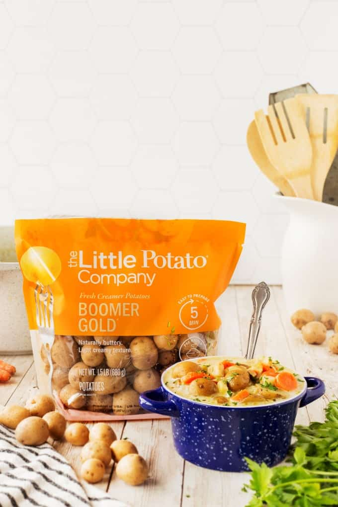 Bowl of potato soup with a bag of potatoes