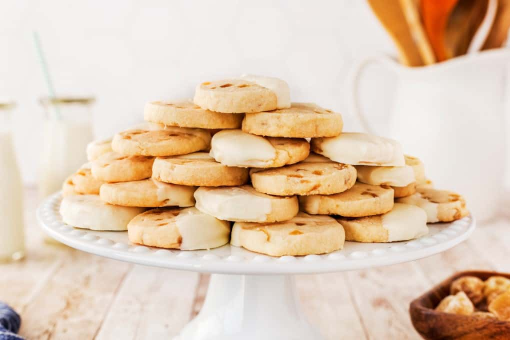 Cookies on a white cake stand