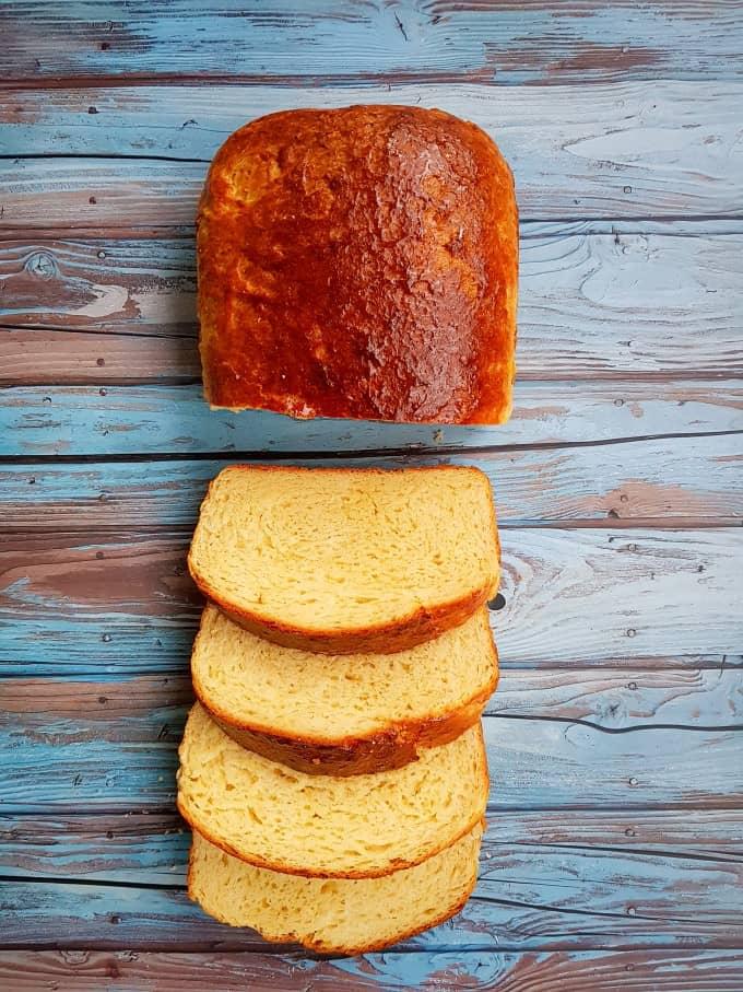 Sliced brioche bread on a blue board