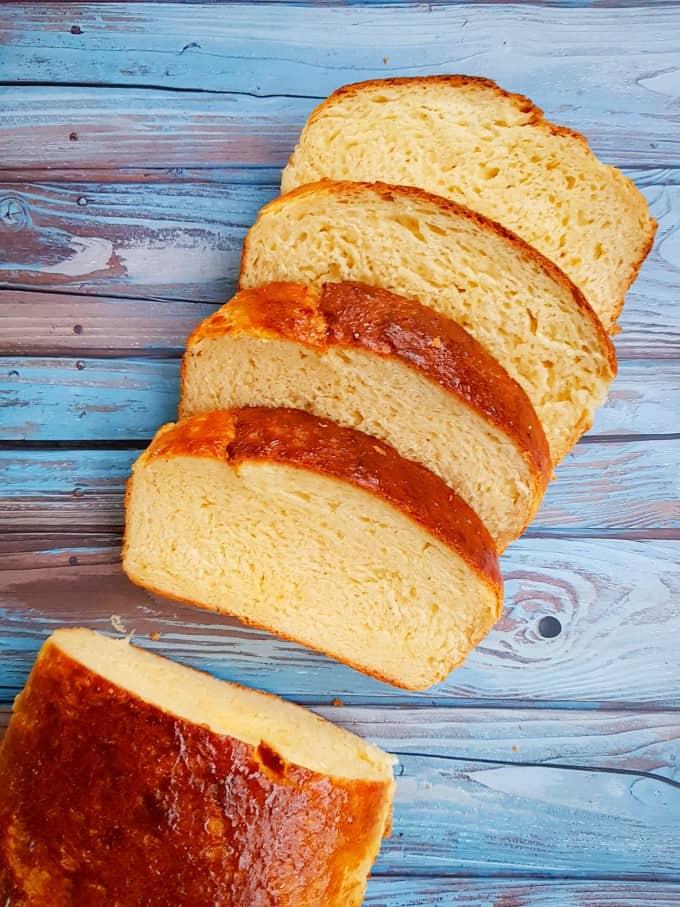 Sliced brioche bread on an angle.