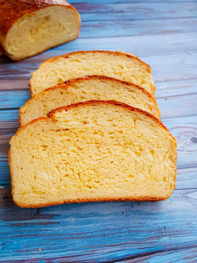Close up of bread sliced on a blue background.