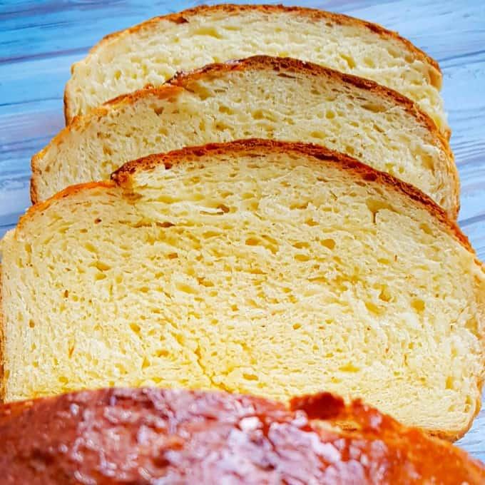 Square photo of sliced brioche bread.