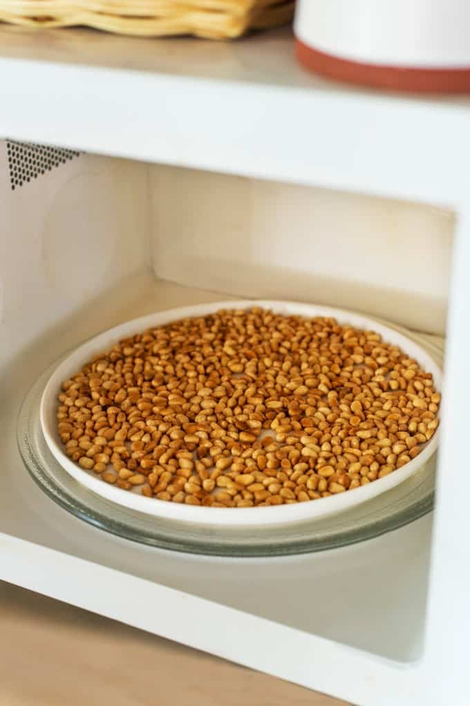 Toasted pine nuts in a microwave.