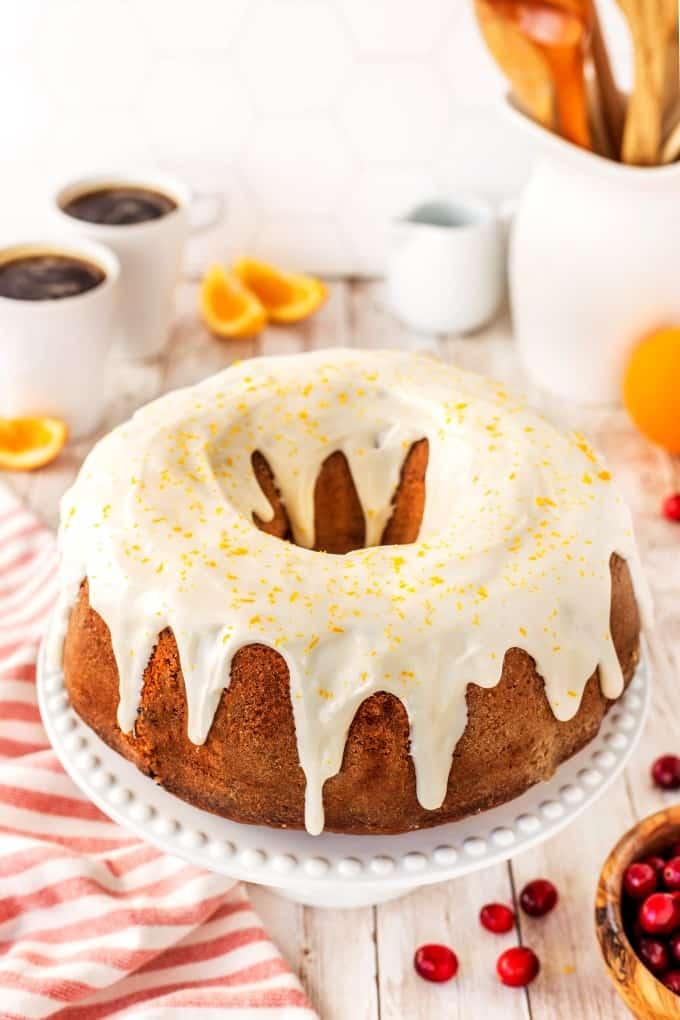 Cranberry Orange Bundt Cake on a cake stand