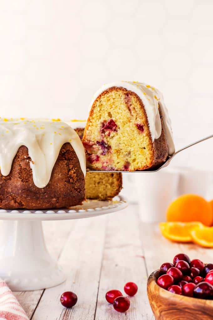 Taking a slice of bundt cake from a cake stand
