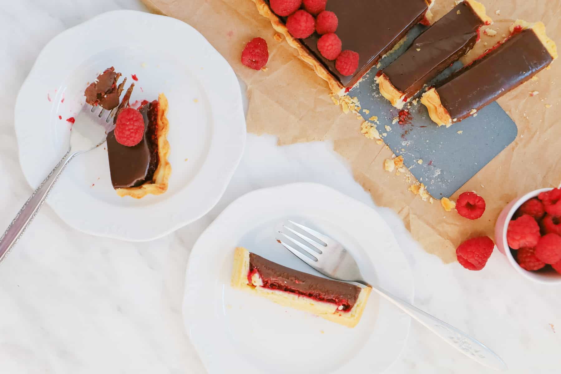 Overhead shot of serving a chocolate tart on plates