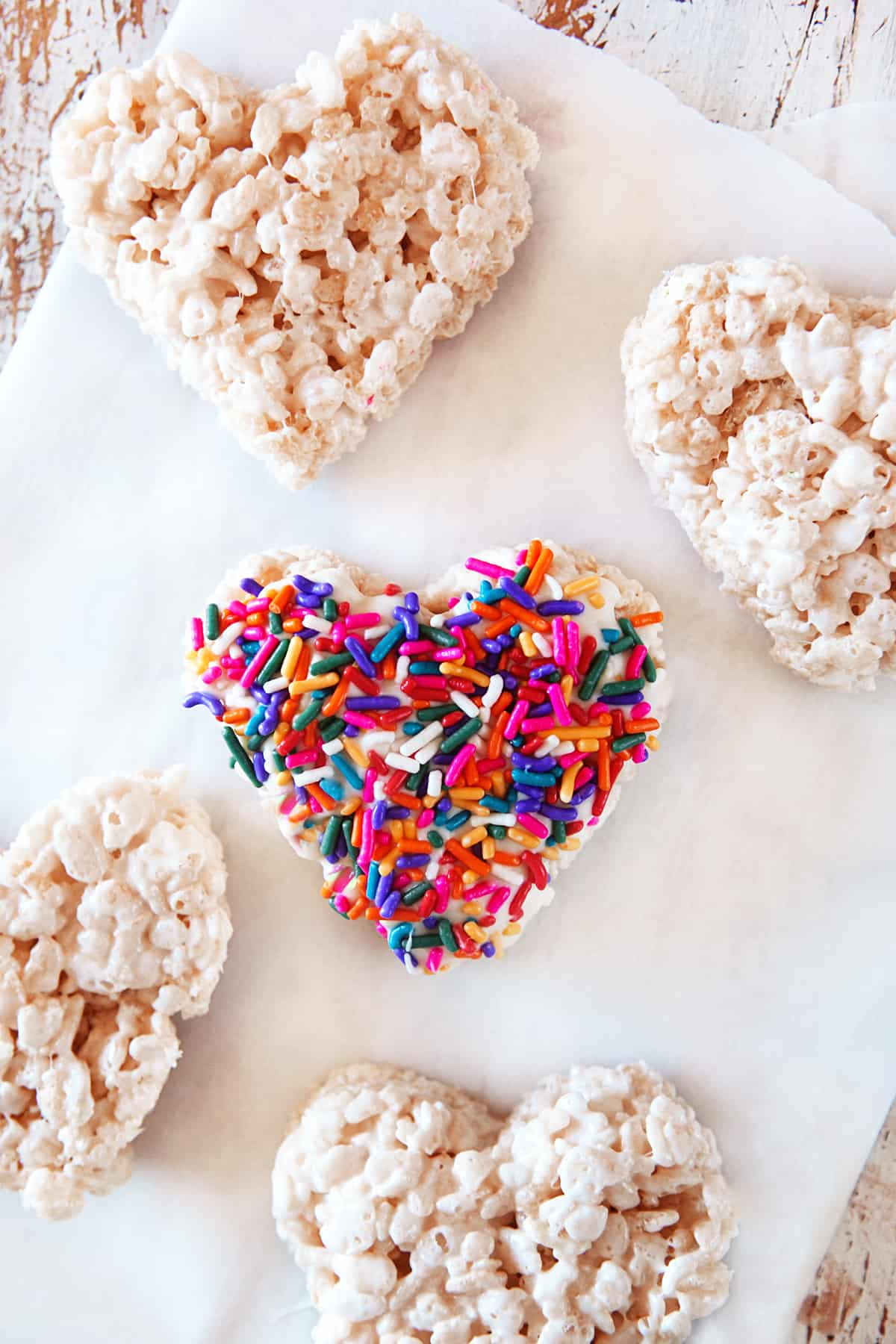 Colorful sprinkles on a heart shaped rice Krispie.