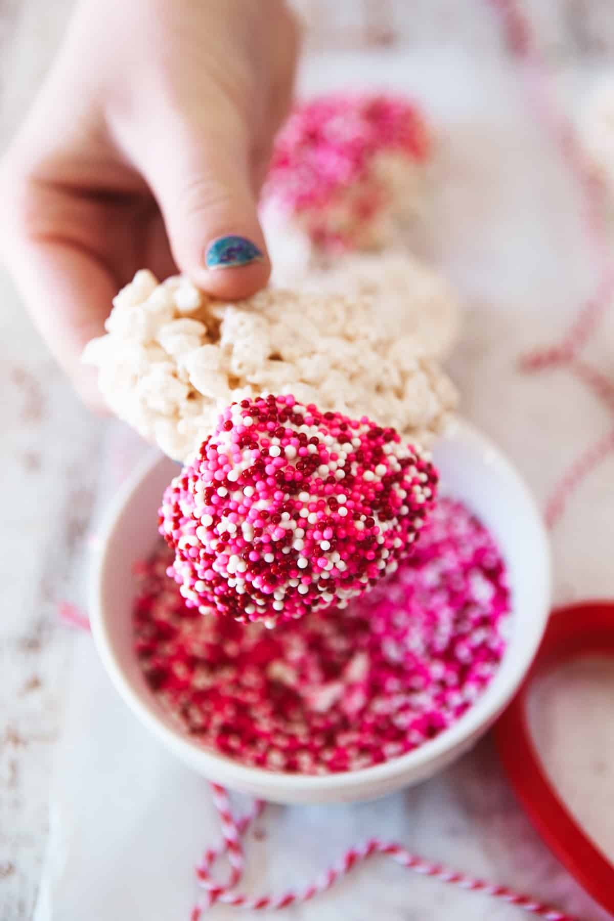 Showing lots of sprinkles on a heart shaped rice Krispie.