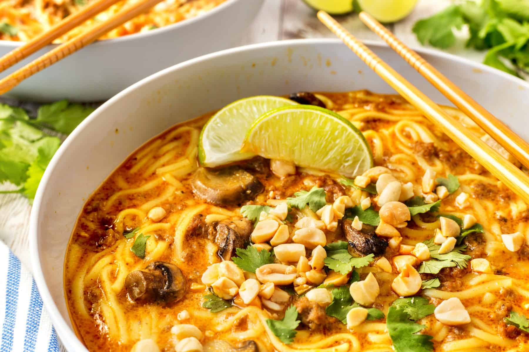 Horizontal close up of beef noodle Thai soup in a bowl