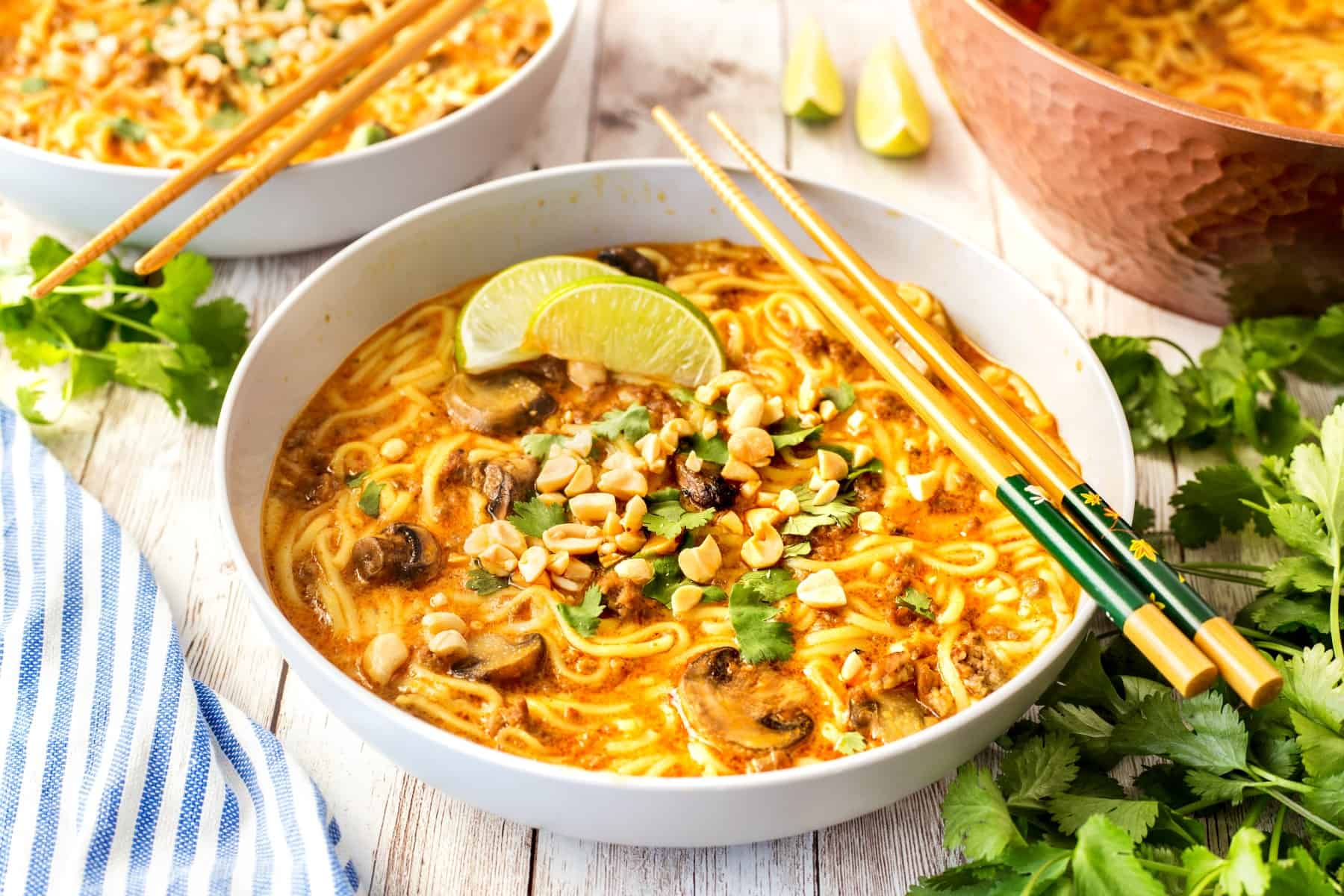 Bowls of 30 Minute Beef Coconut Curry Soup with chopsticks