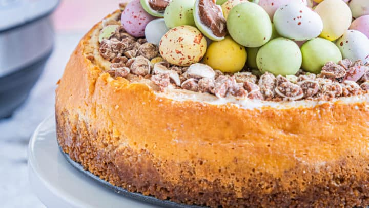 Easter Egg Instant Pot Cheesecake on a stand