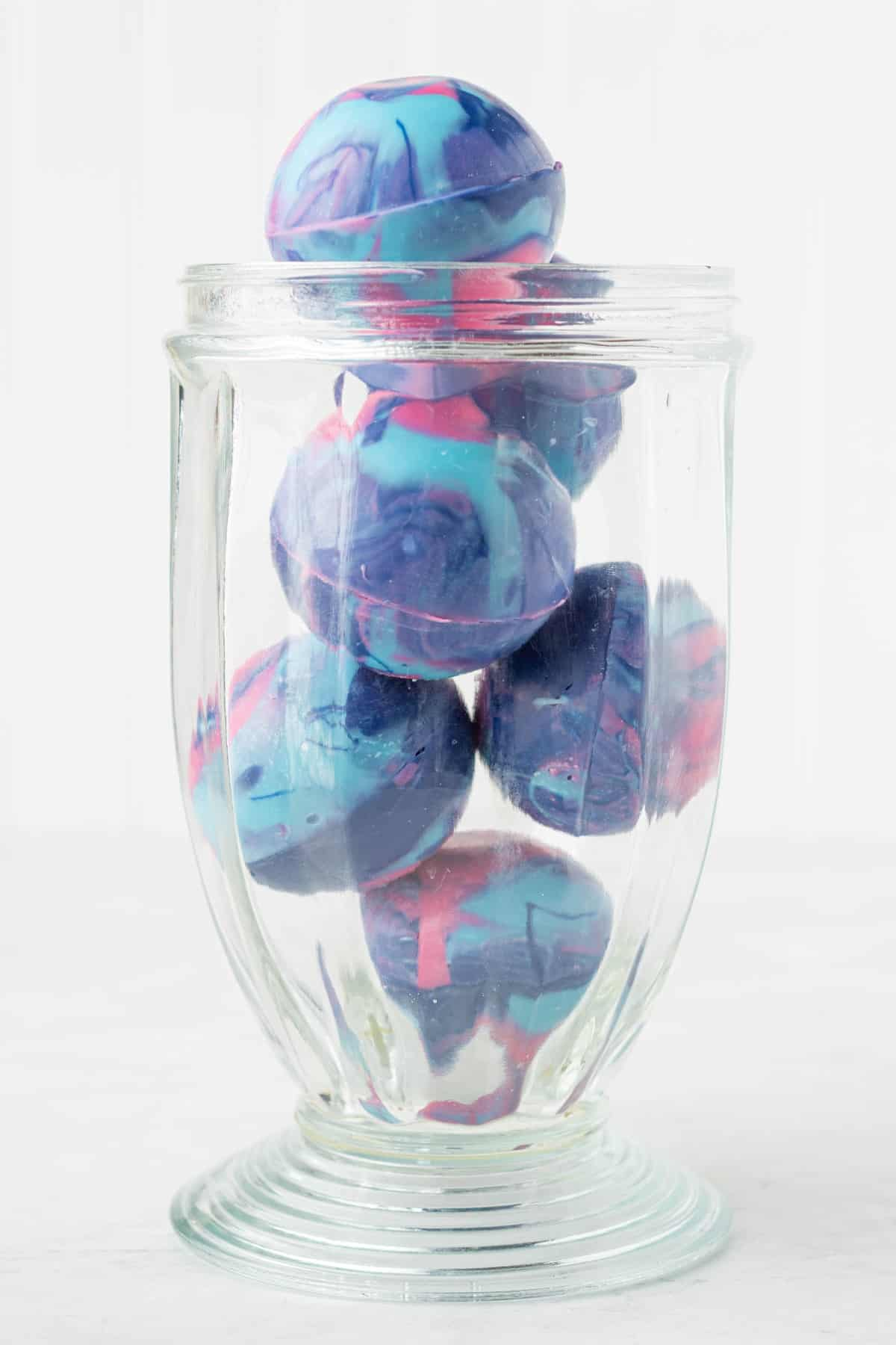 Galaxy Hot Chocolate Bombs in a tall glass container