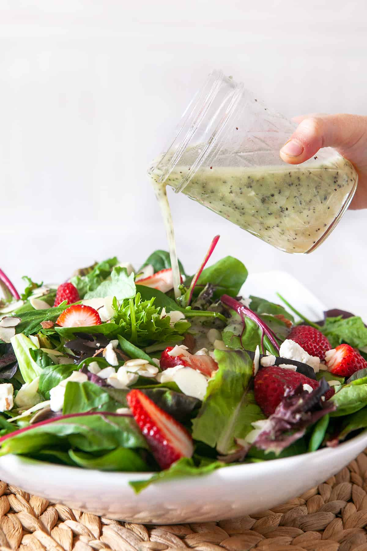 Poppy Seed Dressing on a spinach strawberry salad