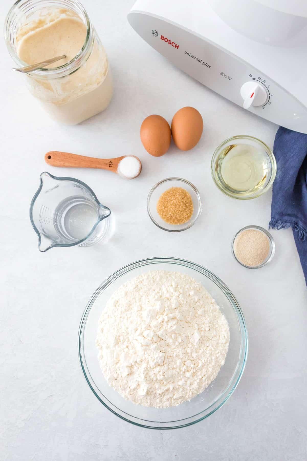 Ingredients for sourdough dinner rolls.