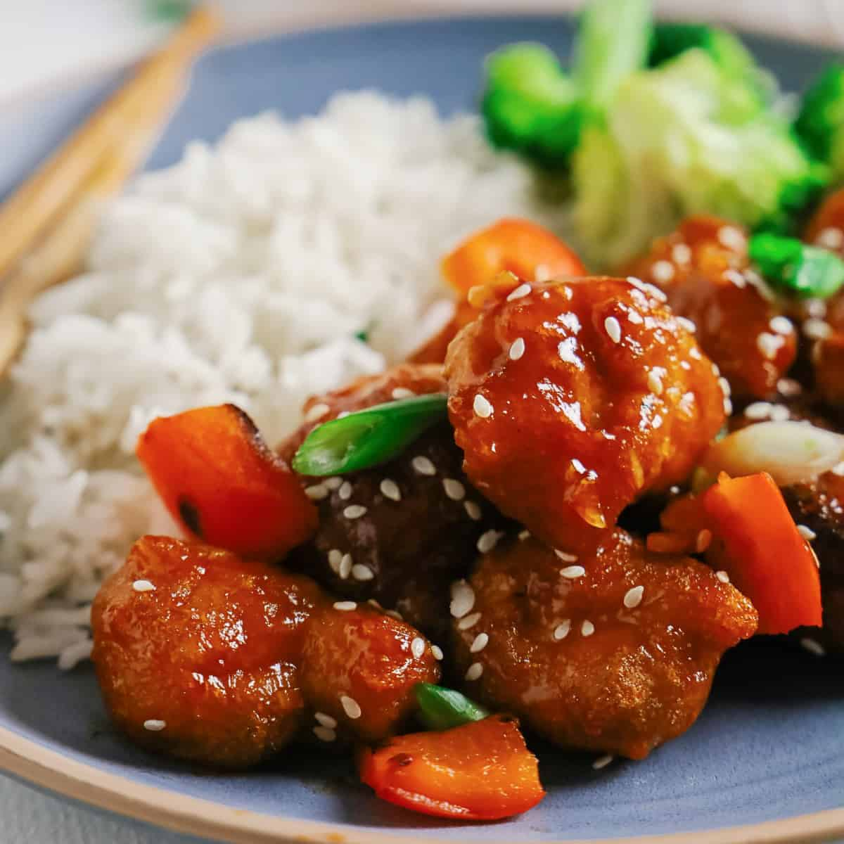 Sweet and Sour Pork with rice and broccoli in a square picture.