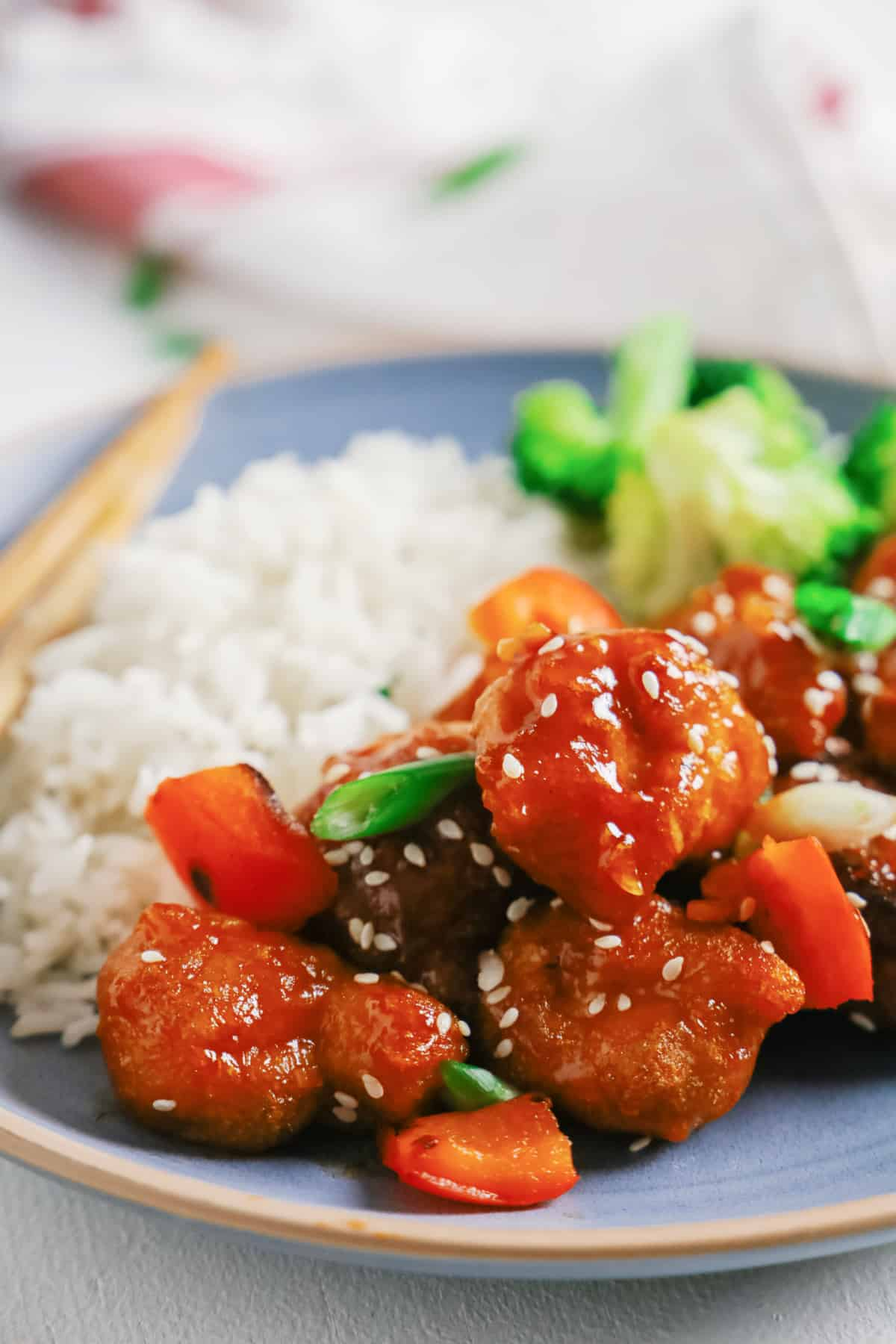 Sweet and Sour Pork on a plate with rice and broccoli
