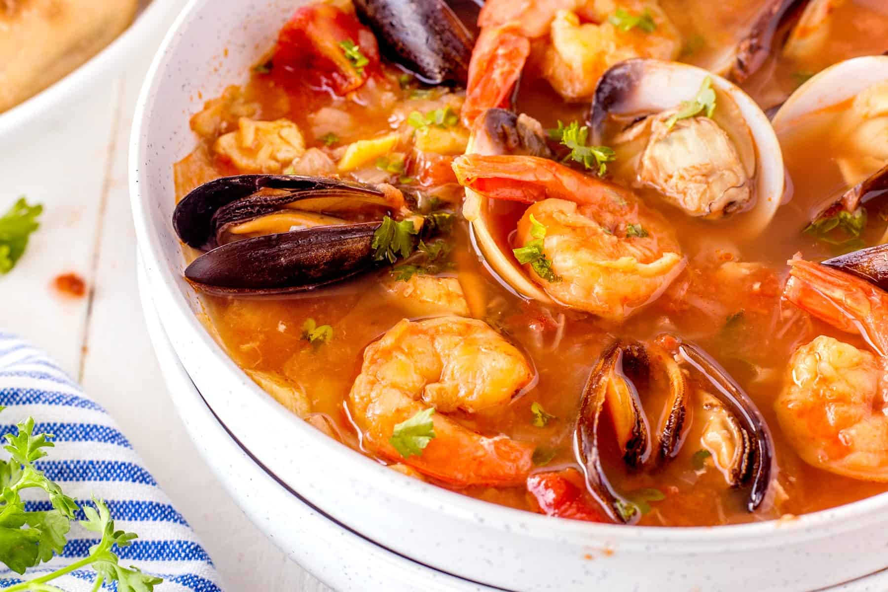 Horizontal pictures of seafood stew.