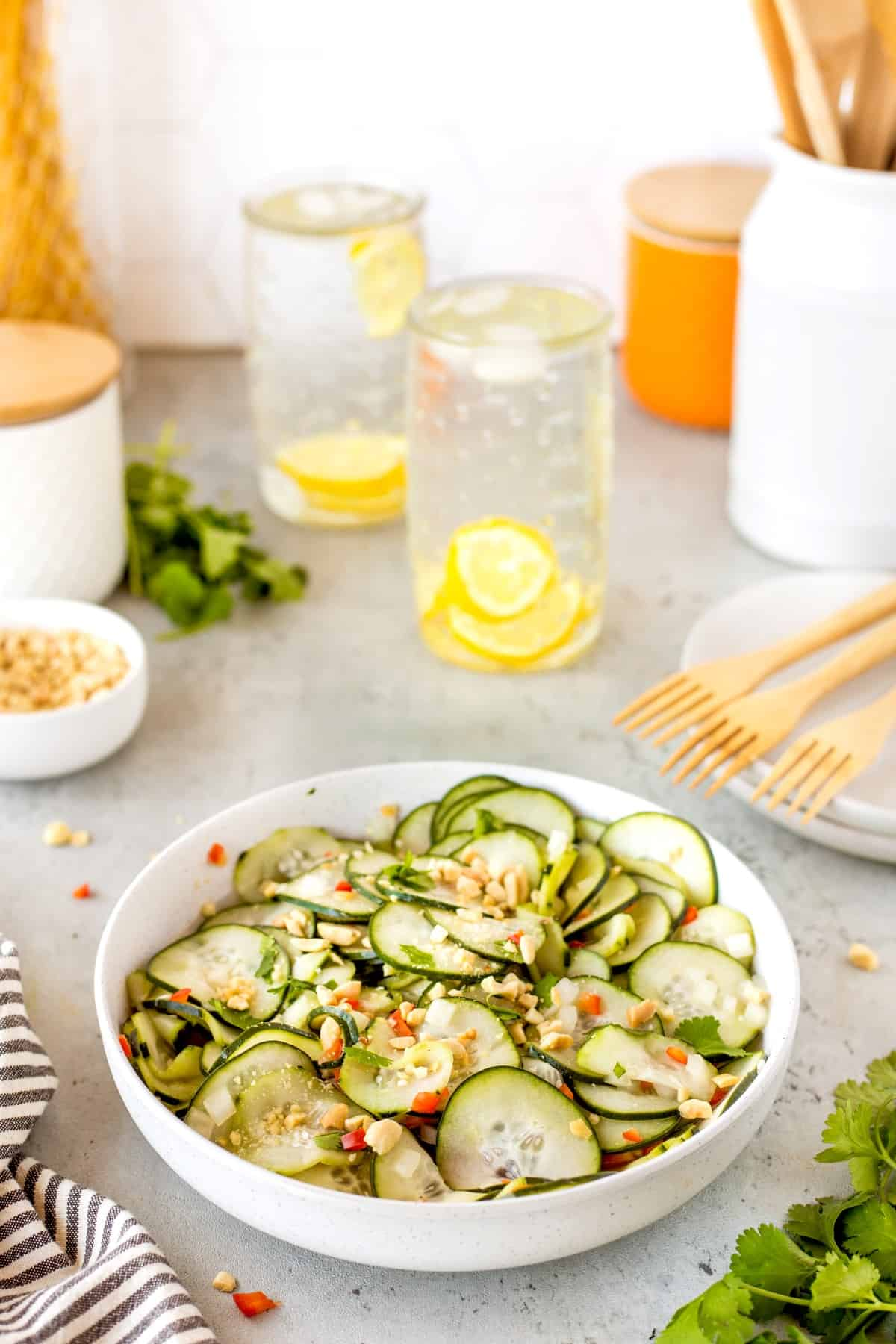 Asian Cucumber salad with chopped peanuts and cilantro on top.