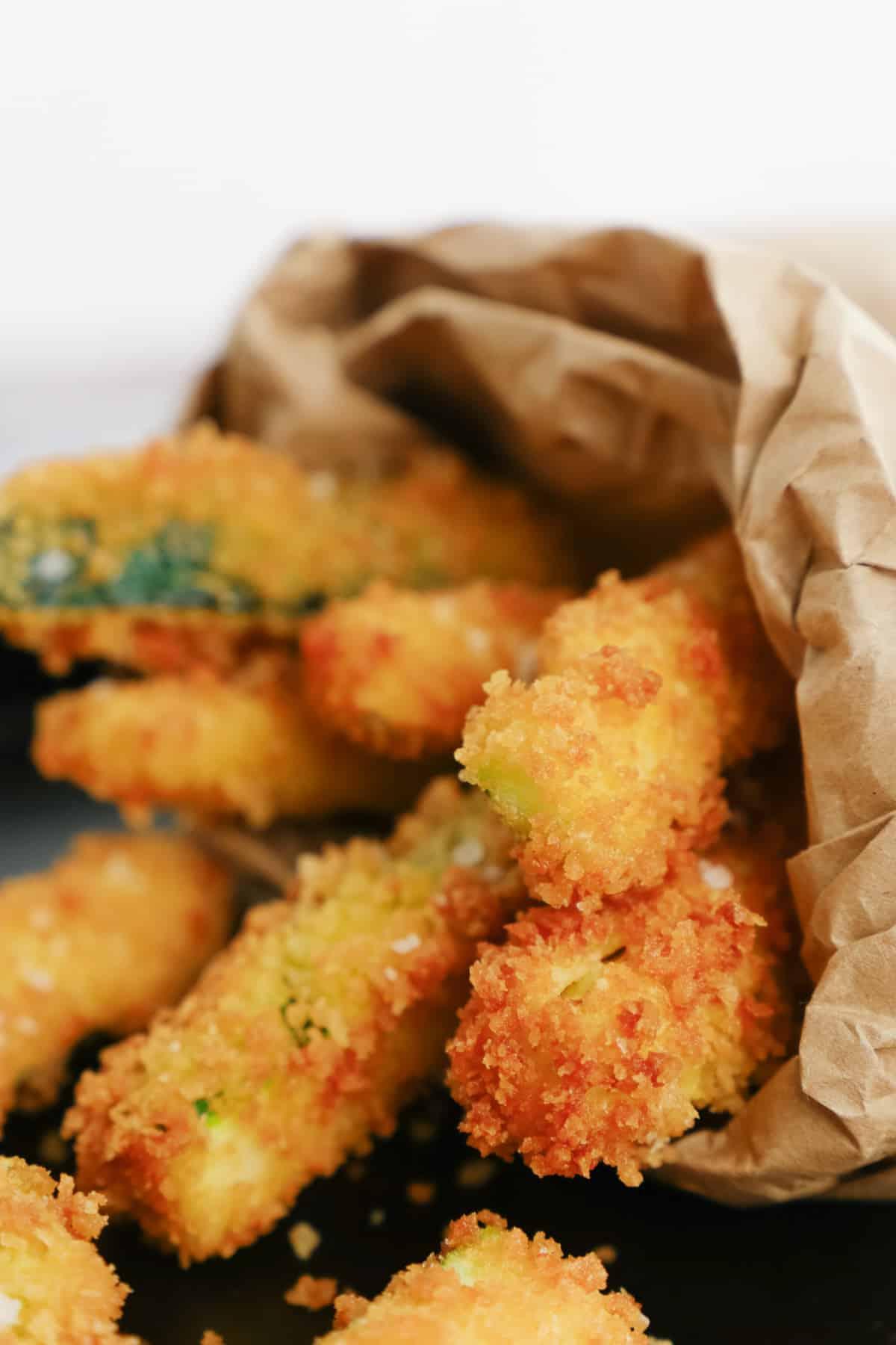 Close up of zucchini sticks in a bag.