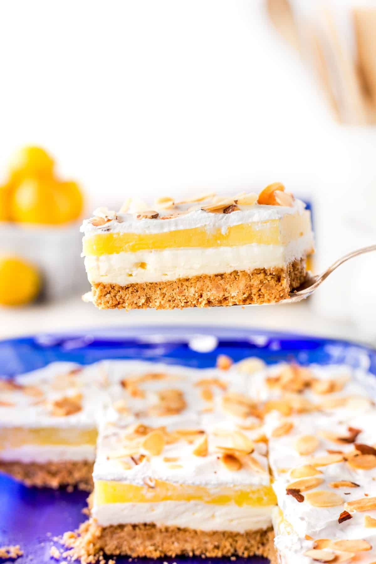 Show a slice of lemon lush dessert on a server.