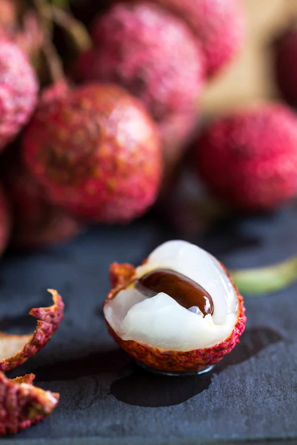 Fresh bunch of Lychees on wooden table