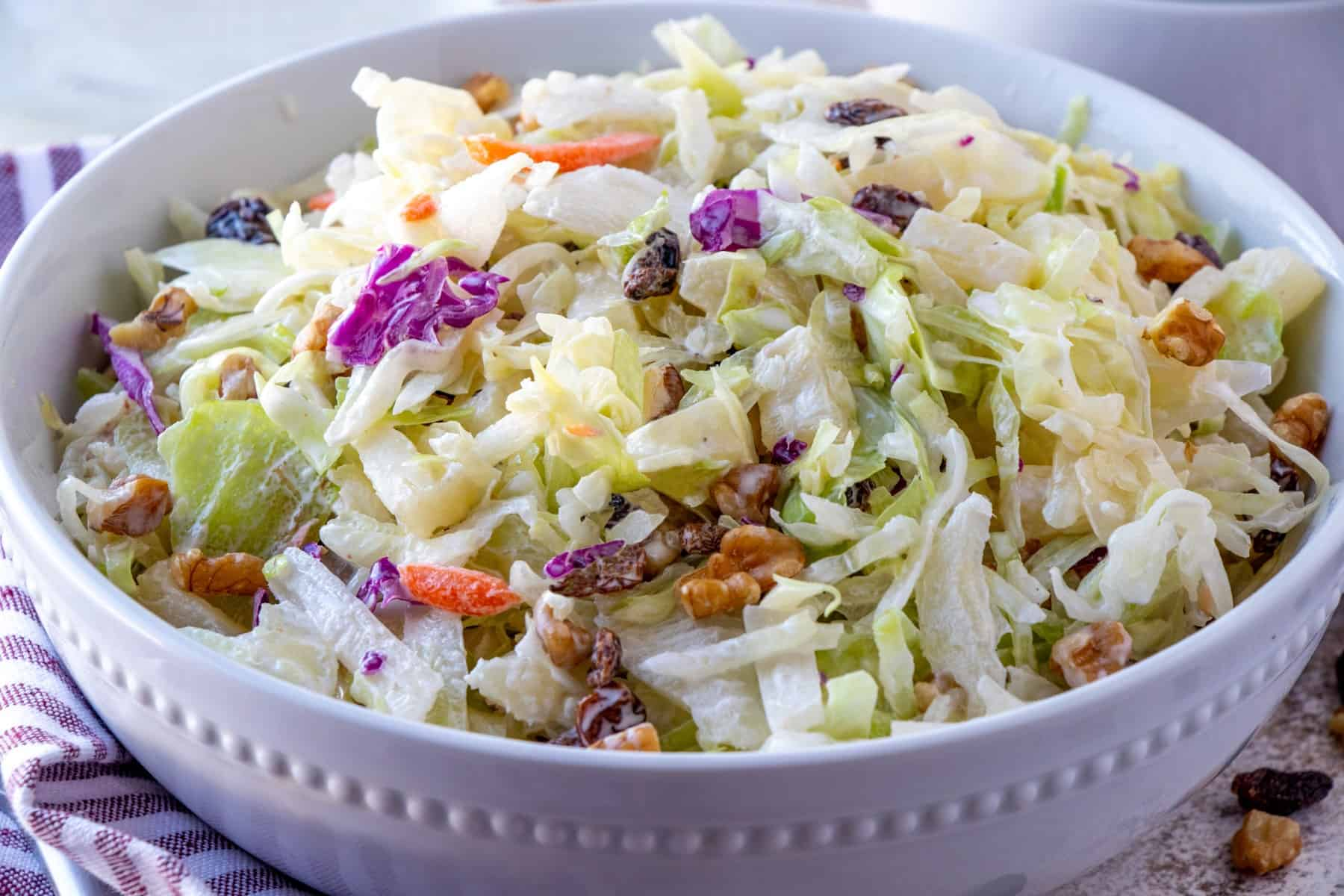 Horizontal shot of coleslaw in a bowl.