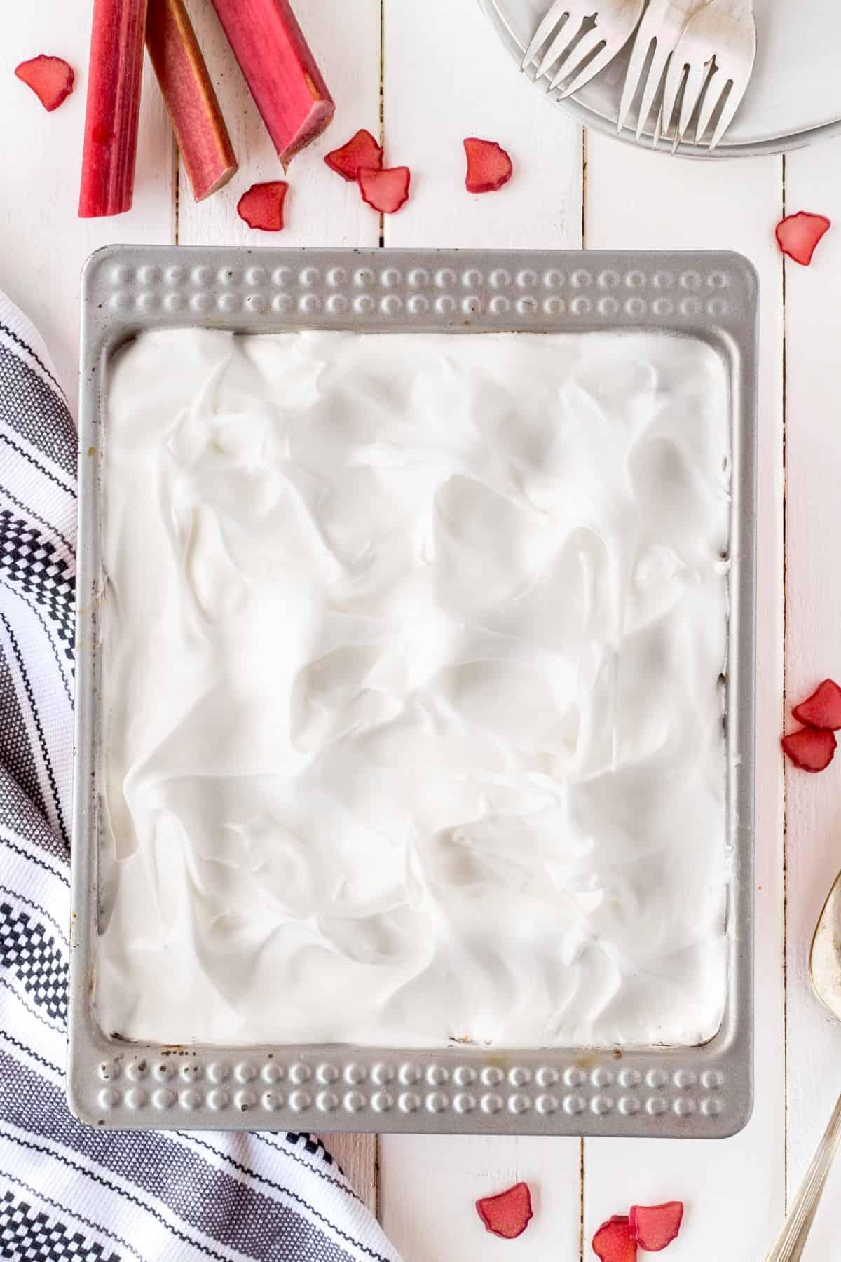 Showing rhubarb meringue dessert in pan from an overhead shot.