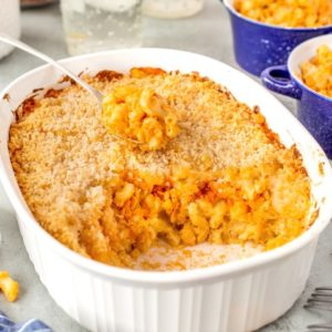 Buffalo Chicken Mac and Cheese in a casserole being scooped out