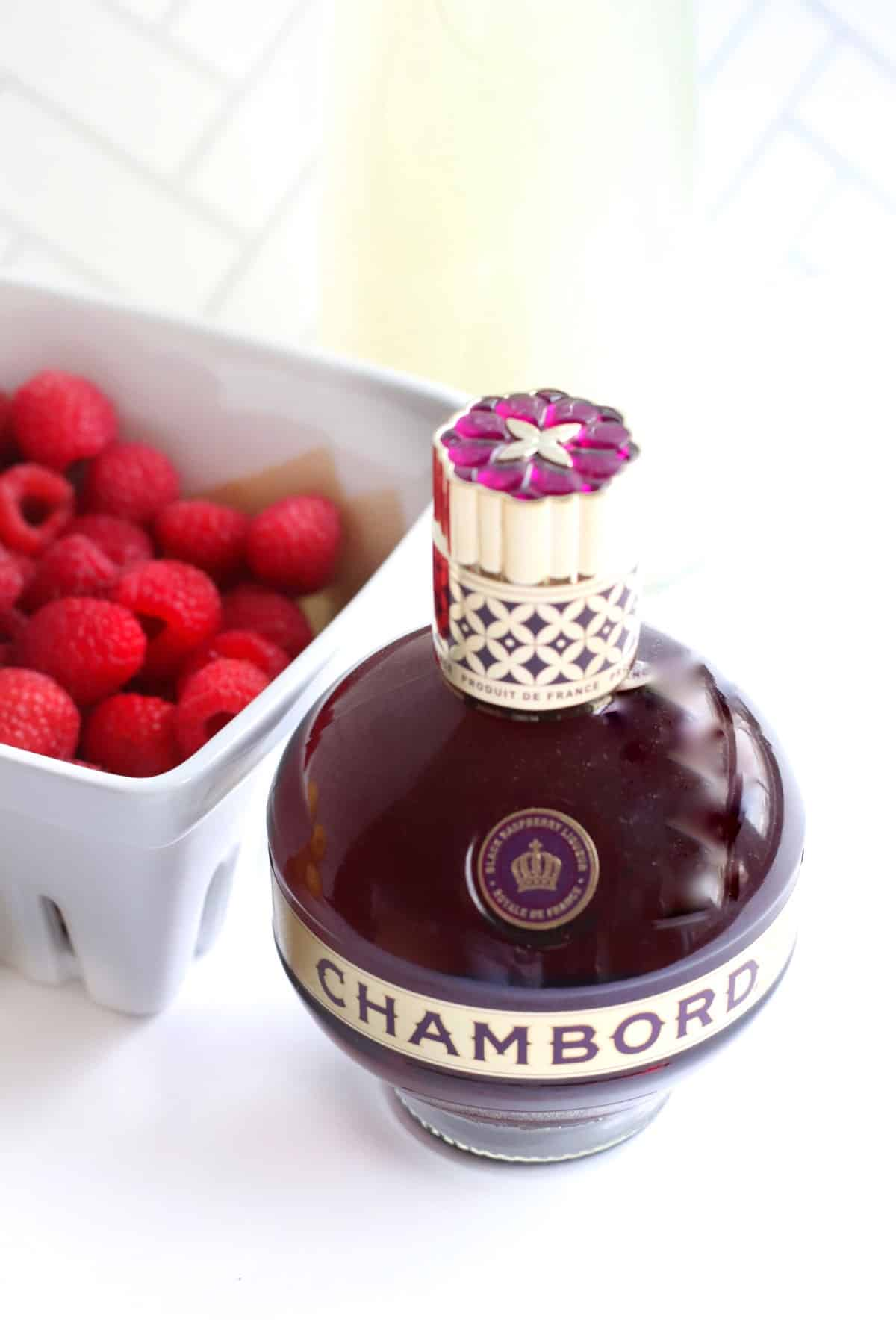 A bottle of Chambord with raspberries