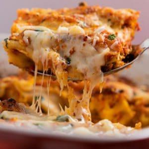 Large spoonful of cheesy manicotti