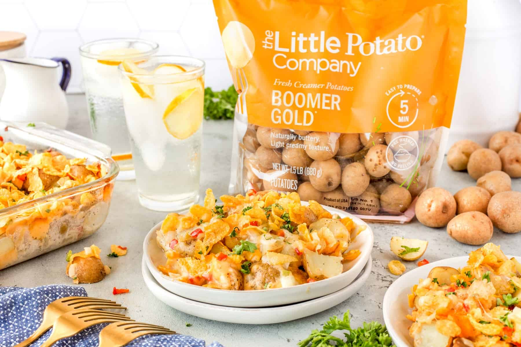 Horizontal shot of Cottage potatoes with a bag of Little Potato Company Potatoes.