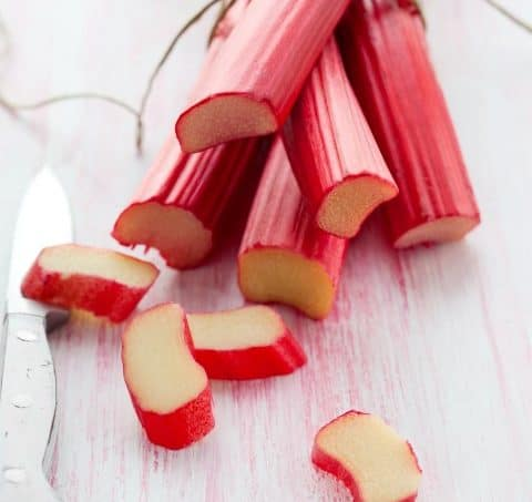 A bunch of rhubarb tied and the first ends sliced