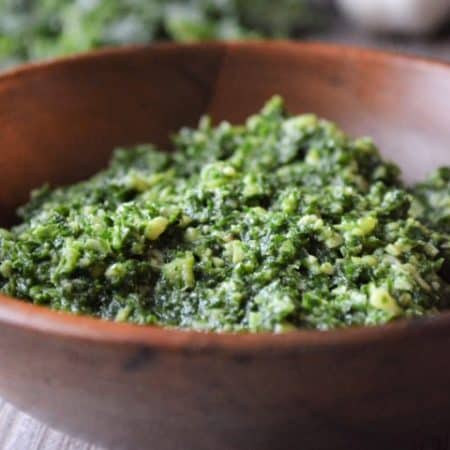 Kale pesto in a wooden bowl