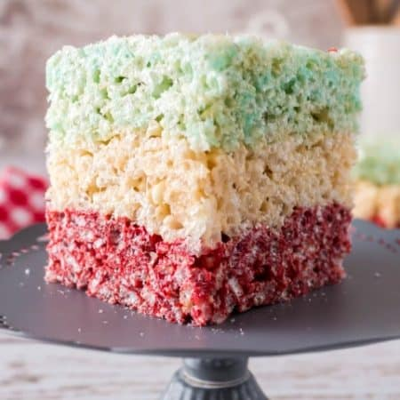 Layered Rice Krispie Square on a pedestal