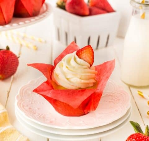 Strawberry Cupcake on a white stack of plates