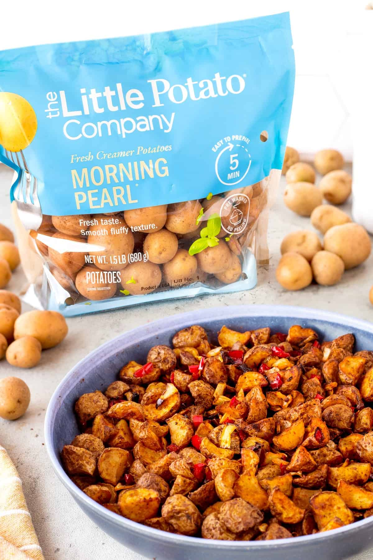 Air Fryer Home Fries in a bowl with Little Potato Company packaging.