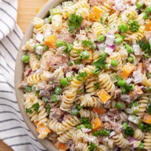 Tuna Pasta Salad in a bowl, overhead shot