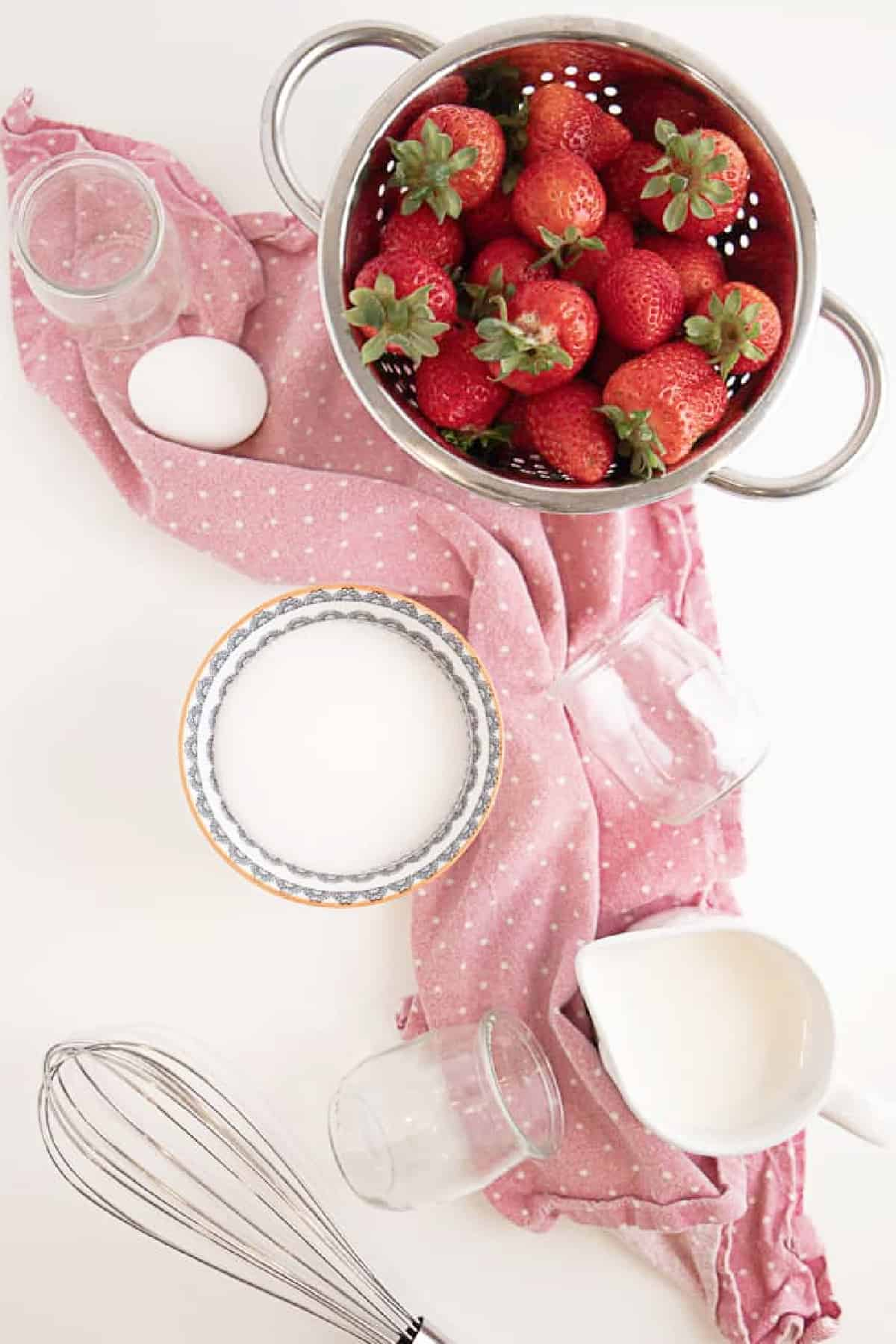 Overhead shot of ingredients for strawberry mousse